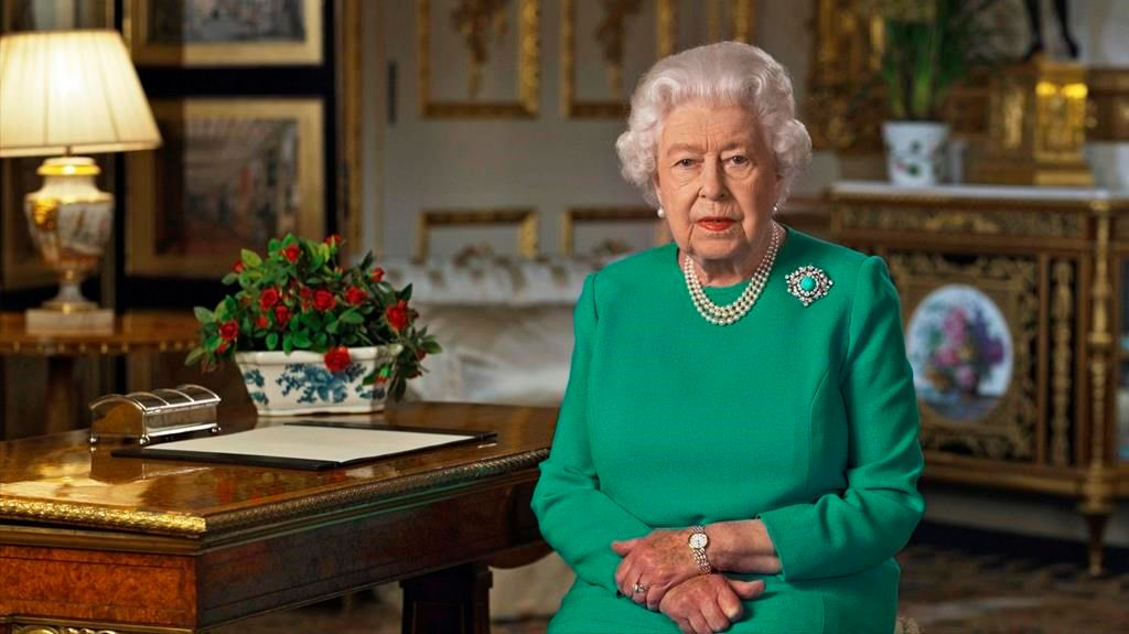 In this image taken from video and made available by Buckingham Palace, Britain's Queen Elizabeth II addresses the nation and the Commonwealth from Windsor Castle, Windsor, England, Sunday April 5, 2020.