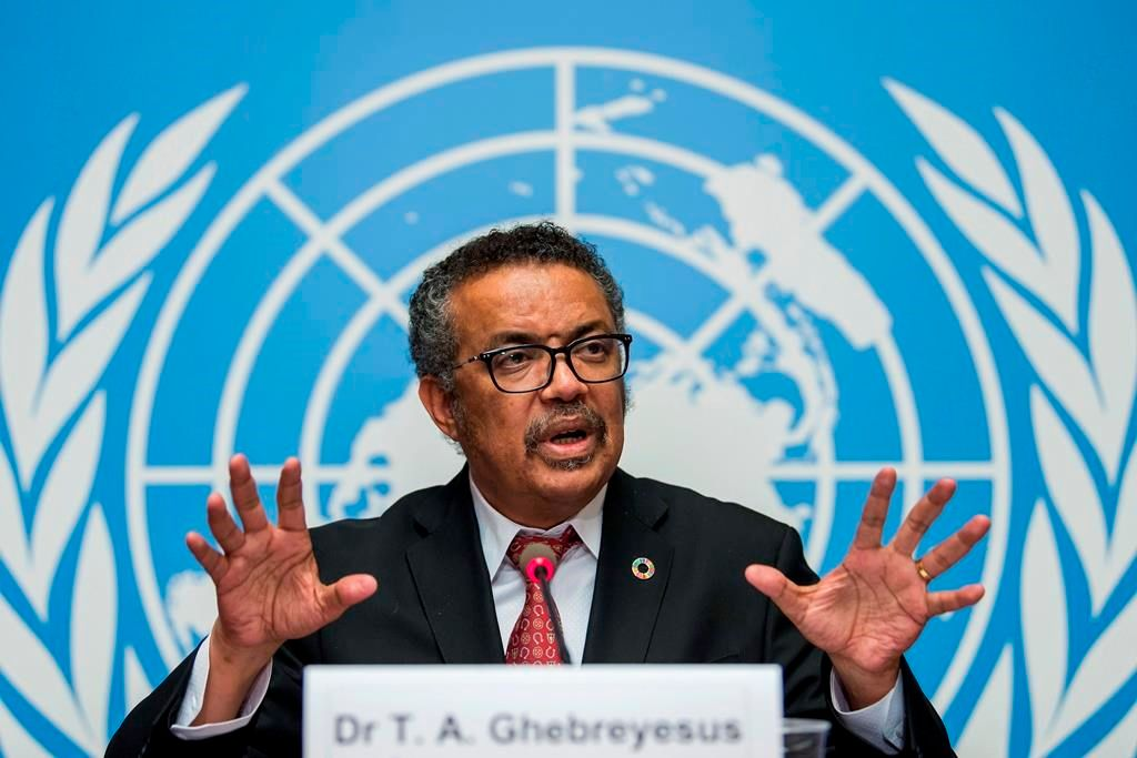 FILE-Int this Feb. 7, 2018 file photo Tedros Adhanom Ghebreyesus, director general of the World Health Organization (WHO), answers questions of the journalists about his first seven months in office and outlines the organization's priorities for the next five years, at the European headquarters of the United Nations in Geneva, Switzerland. The World Health Organization's director-general has faced many challenges during the coronavirus pandemic: racial slurs, death threats, social media caricatures — he was once depicted as a ventriloquist's dummy in the hands of Chinese President Xi Jinping — and U.S. funding cuts. (Martial Trezzini/Keystone via AP).