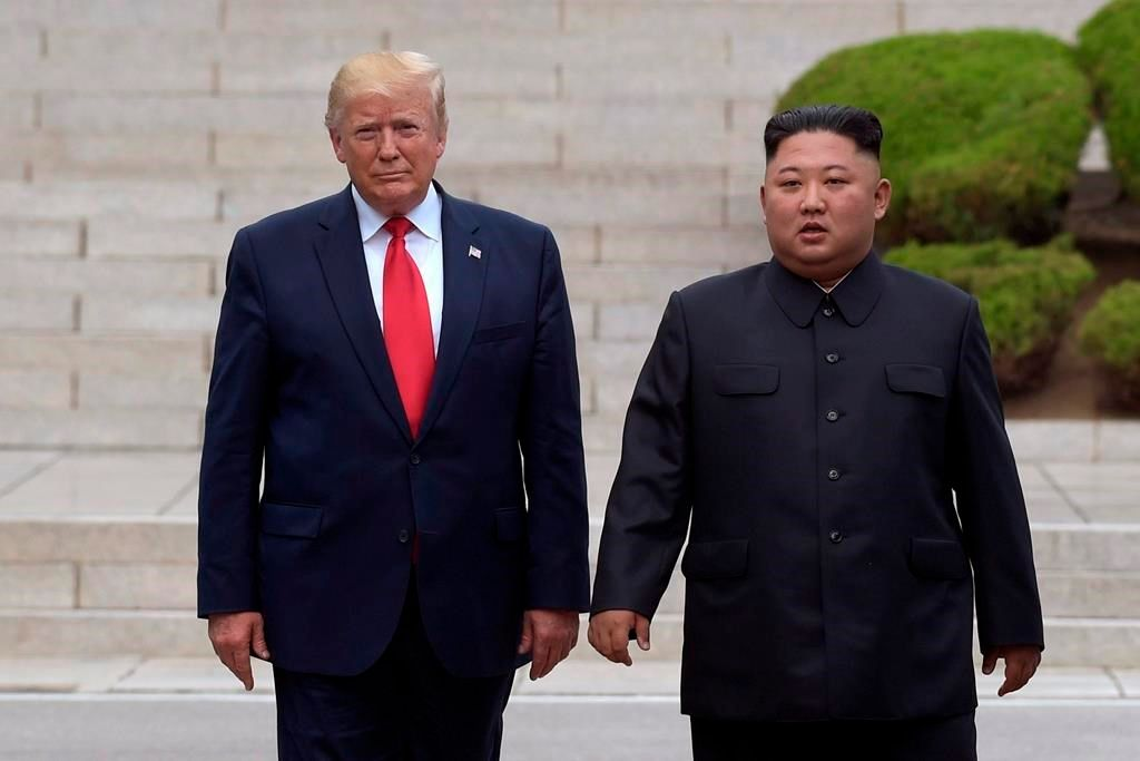 In this June 30, 2019, file photo President Donald Trump, left, meets with North Korean leader Kim Jong Un at the North Korean side of the border at the village of Panmunjom in Demilitarized Zone.