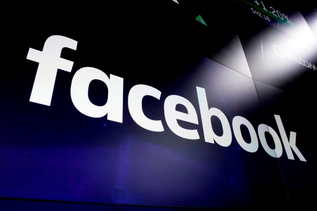 This March 29, 2018 file photo, shows logo for social media giant Facebook at the Nasdaq MarketSite in New York's Times Square.THE CANADIAN PRESS/AP-Richard Drew.