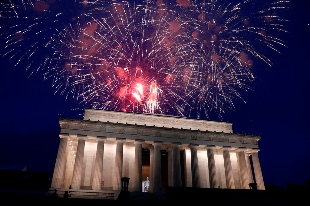 FILE - In this July 4, 2019 file photo, fireworks go off over the Lincoln Memorial in Washington, Thursday, July 4, 2019. The Trump administration is promising one of the largest fireworks displays in recent memory for Washington on July 4. It also plans to give away as many as 300,000 face masks to those who come down to the National Mall, although they won't be required to wear them. (AP Photo/Susan Walsh).