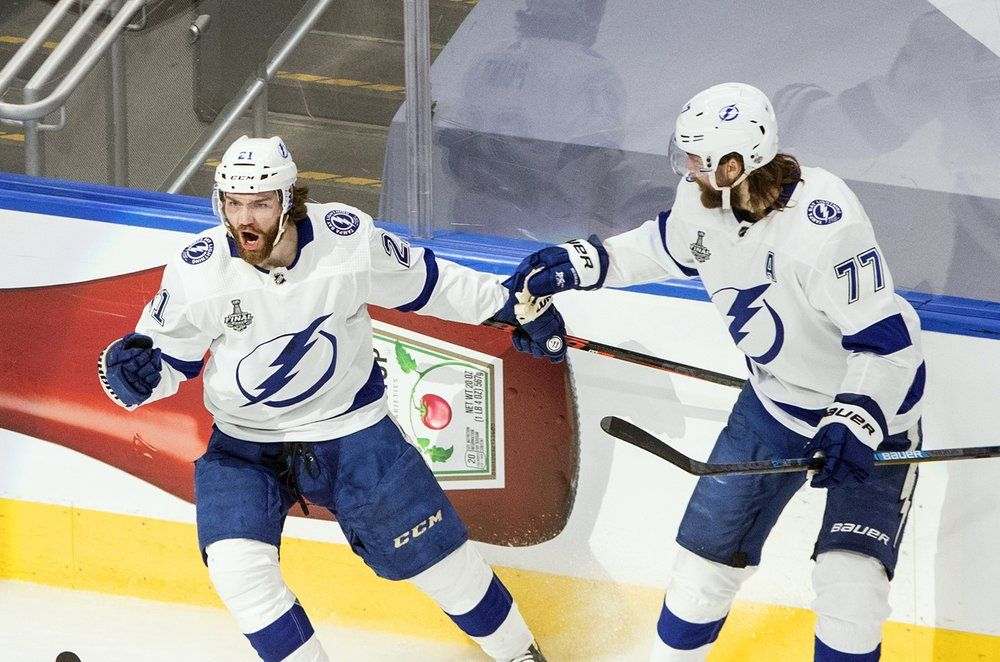 Tampa Bay Lightning's Brayden Point (21) celebrates his goal against the Dallas Stars with Victor Hedman (77) during first-period NHL Stanley Cup finals hockey game action in Edmonton, Alberta, Monday, Sept. 28, 2020.