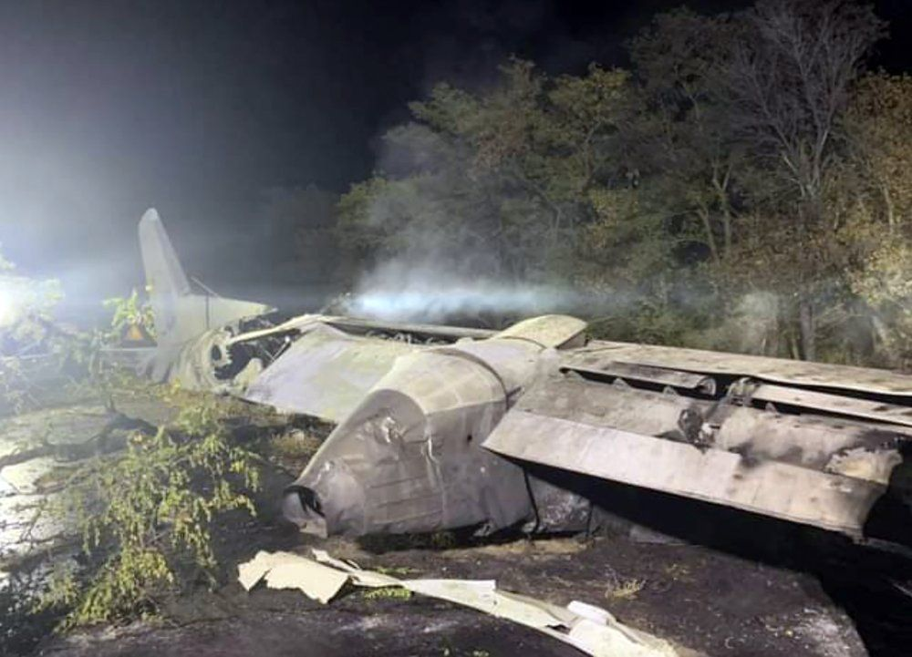 In this photo released by Kharkiv Regional State Administration, wreckage of an AN-26 military plane seen after it crashed in the town of Chuguyiv close to Kharkiv, Ukraine, late Friday, Sept. 25, 2020. A Ukrainian military plane carrying students at an aviation school crashed and burst into flames while landing, killing more than twenty people. Two other people on board were seriously injured and four people were missing.