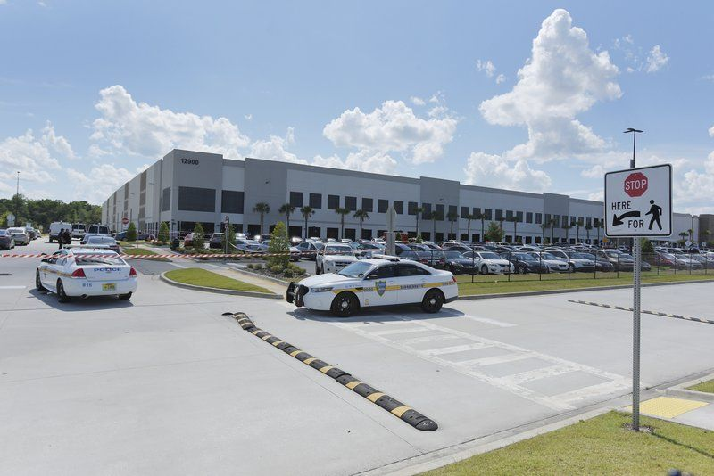 FILE - In this Monday, June 29, 2020, file photo, law enforcement respond to a report of a shooting at the Amazon Fulfillment Center on Pecan Park Road near the Jacksonville International Airport in Jacksonville, Fla. The Jacksonville Sheriff's Department said on its Twitter account late Tuesday, Sept. 29, 2020, that there was a report of a shooting at the Amazon Fulfillment Center. The center was also the site of a shooting in June.
