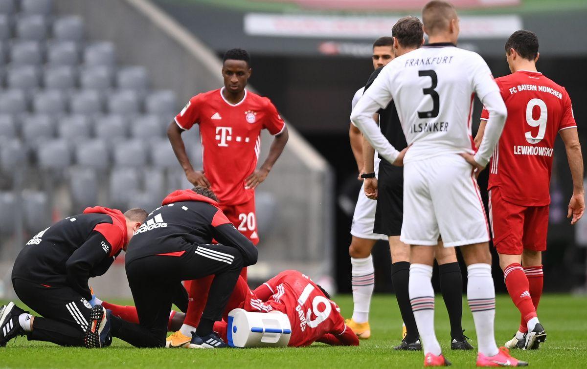 Bayern's Alphonso Davies (aground) receives medical attention during the German Bundesliga soccer match between FC Bayern Munich and Eintracht Frankfurt, in Munich, Germany, 24 October 2020.