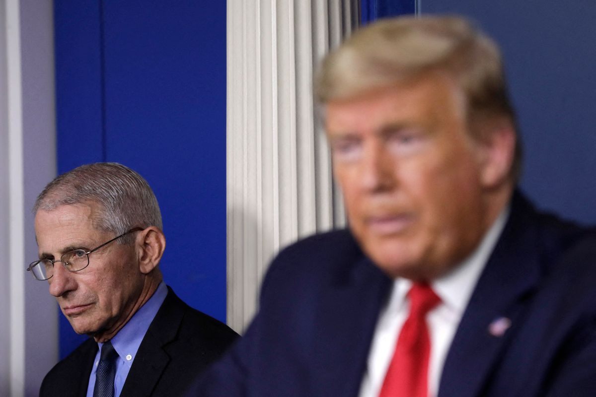 File photo dated March 26, 2020 of President Donald Trump speaks next to Director of the National Institute of Allergy and Infectious Diseases Dr. Anthony Fauci during a press briefing on the Coronavirus COVID-19 pandemic at the White House in Washington, DC, USA.