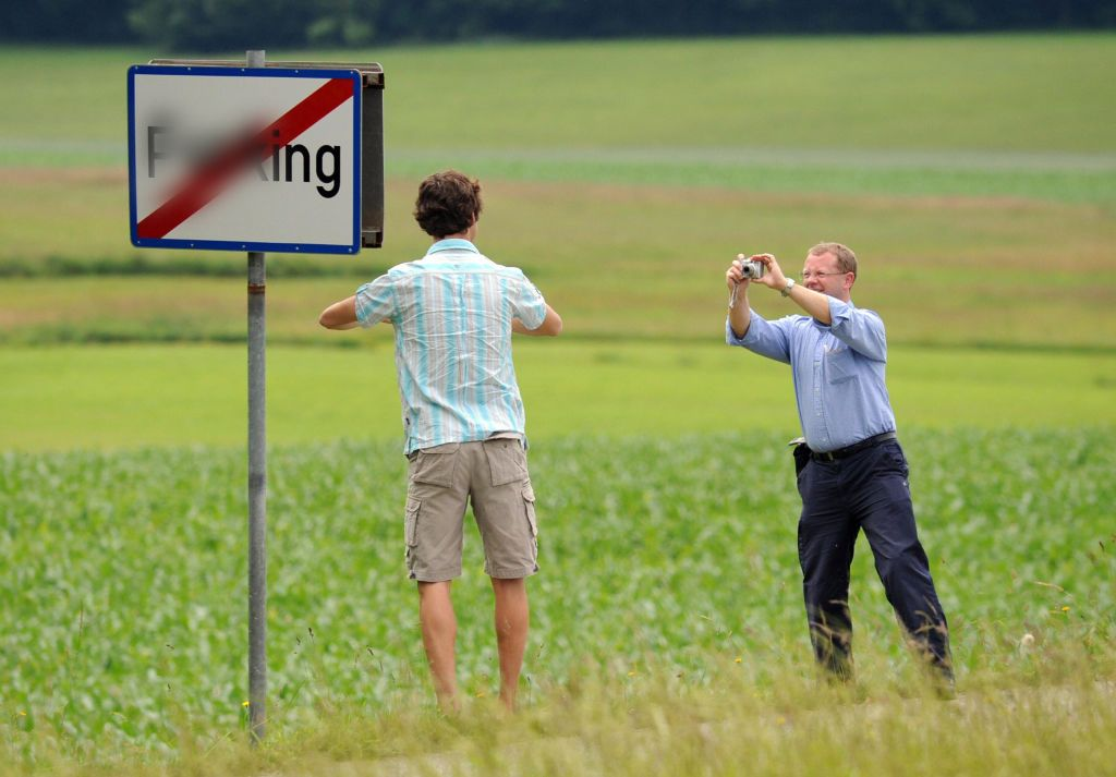 In this censored file photo, tourists take photos with the town sign on June 18, 2008.