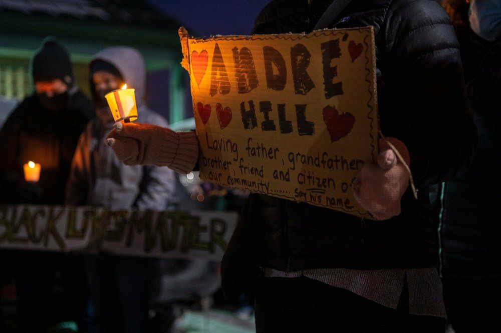 A vigil is held for Andre' Hill at the Brentnell Community Recreation Center on Columbus. Ohio, Saturday, Dec. 26, 2020. The police chief of Columbus, Ohio, recommended on Thursday, Dec. 24, 2020, that the officer who shot and killed Hill, a 47-year-old Black man, earlier this week be fired.