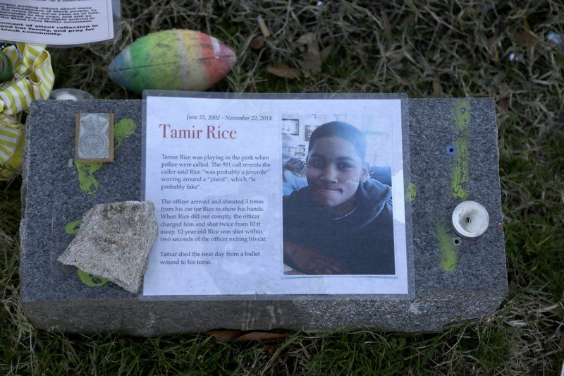 FILE - In this Dec. 13, 2020, file photo a memorial for Tamir Rice is seen at the base of the Gen. Robert E. Lee statue is seen Sunday Dec. 13, 2020 in Richmond, Va. The Justice Department announced Tuesday, Dec. 29, 2020, that it would not bring federal criminal charges against two Cleveland police officers in the 2014 killing of 12-year-old Tamir Rice, saying video of the shooting was of too poor a quality for prosecutors to conclusively establish what had happened.