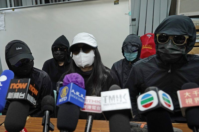 Relatives of 12 Hong Kong activists detained at sea by Chinese authorities, attend a press conference in Hong Kong, Monday, Dec. 28, 2020. Trials for 10 people accused of attempting to flee Hong Kong by speedboat amid a government crackdown on dissent got underway in China on Monday, a court official said. The defendants face charges of illegally crossing the border, while two face additional charges of organizing the attempt, according to an indictment issued in the southern city of Shenzhen.