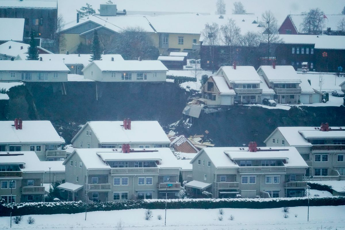 A view of houses on the edge of a landslide in the village Ask, some 40 km north of Oslo, Norway, 30 December 2020.