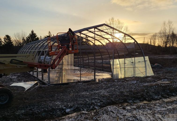 The Potlotek First Nation in Cape Breton, along with other Indigenous communities in Atlantic Canada, is in the midst of a new gardening project to address food insecurity with a geothermally-heated greenhouse, shown under construction in a handout photo, to allow for year-round food production.