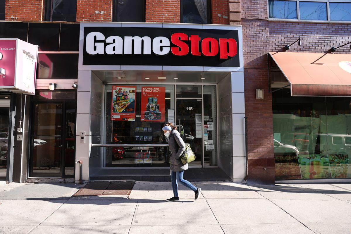 NEW YORK, NEW YORK - JANUARY 28: People walk by a GameStop store in Brooklyn on January 28, 2021 in New York City. Markets continue a volatile streak with the Dow Jones Industrial Average rising over 500 points in morning trading following yesterdays losses. Shares of the video game retailer GameStop plunged. (Photo by Spencer Platt/Getty Images).