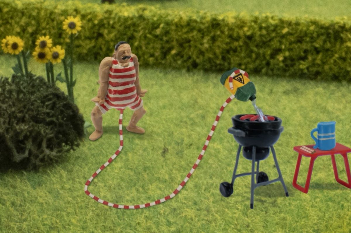 The main character from 'John Dillermand' uses his penis to start a barbecue in this image from the show.