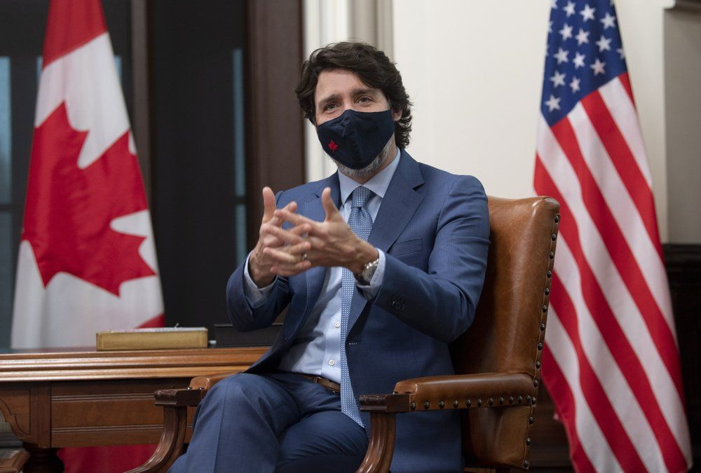 Canadian Prime Minister Justin Trudeau is seen as he speaks virtually with United States President Joe Biden from his office on Parliament Hill in Ottawa, Ontario, Tuesday, Feb. 23, 2021.