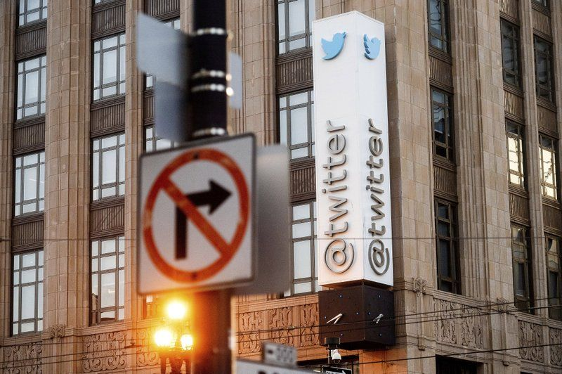 FILE - In this Jan. 11, 2021, file photo, a sign hangs at Twitter headquarters in San Francisco. Republican state lawmakers are pushing for social media giants to face costly lawsuits for policing content on their websites, taking aim at a federal law that prevents internet companies, like Twitter, from being sued for removing posts.