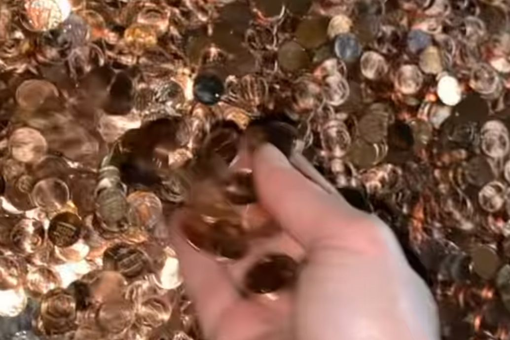 Thousands of pennies are shown outside a home in Fayetteville, Ga., on March 12, 2021.