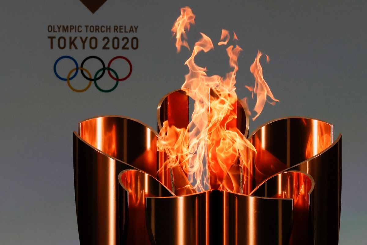 The celebration cauldron is seen lit on the first day of the Tokyo 2020 Olympic torch relay in Naraha, Fukushima prefecture, northeastern Japan, Thursday, March 25, 2021. The torch relay for the postponed Tokyo Olympics began its 121-day journey across Japan on Thursday and is headed toward the opening ceremony in Tokyo on July 23.