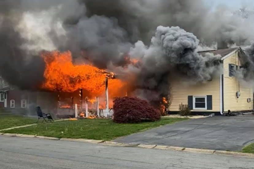 A lawn chair sits in front of a burning home in Elkton, Md., on April 29, 2021.