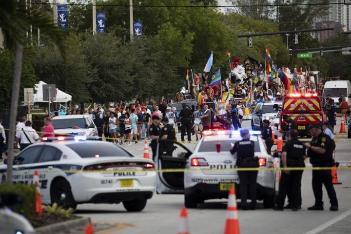 Police and firefighters respond after a truck drove into a crowd of people injuring them during The Stonewall Pride Parade and Street Festival in Wilton Manors, Fla., on Saturday, June 19, 2021. WPLG-TV reports that the driver of the truck was taken into custody.