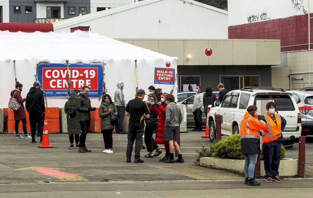 People queue outside a COVID-19 testing station in central Wellington, New Zealand, Wednesday, June, 23, 2021.