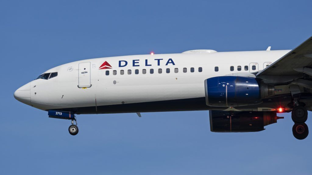 A Delta Air Lines Boeing 737-800 (N383DN) narrow-body single-aisle jet airliner airborne on short final approach for landing at Vancouver International Airport, Richmond, B.C. on Tuesday, September 25, 2018. THE CANADIAN PRESS IMAGES/Bayne Stanley.