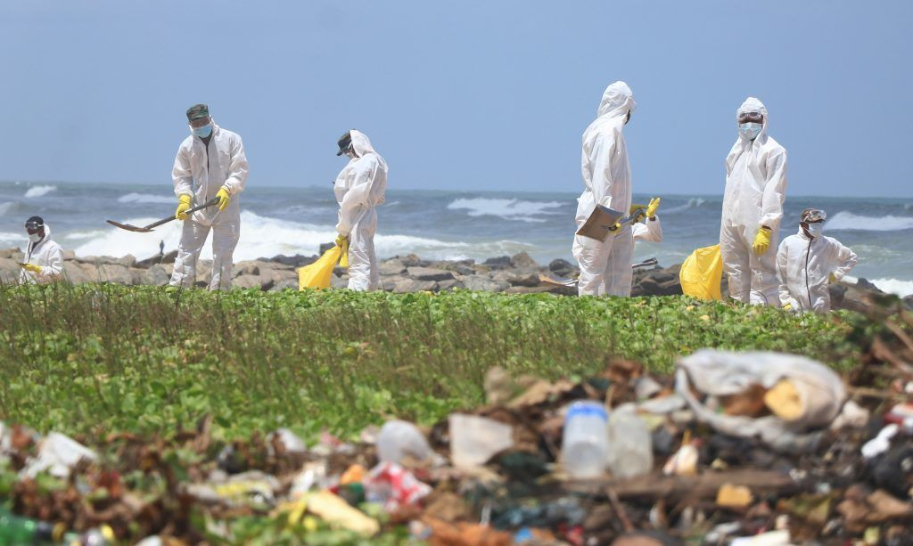 June 1, 2021, Colombo, Western Province, Sri Lanka: Sri Lanka Army personnel remove debris on the beach at Moratuwa, near Colombo. Debris had been washed ashore throughout the past week from a Singaporean container ship, MV X-Press Pearl, that had caught fire about ten nautical miles away from the Colombo Harbour. (Credit Image: © Saman Abesiriwardana/Pacific Press via ZUMA Wire).