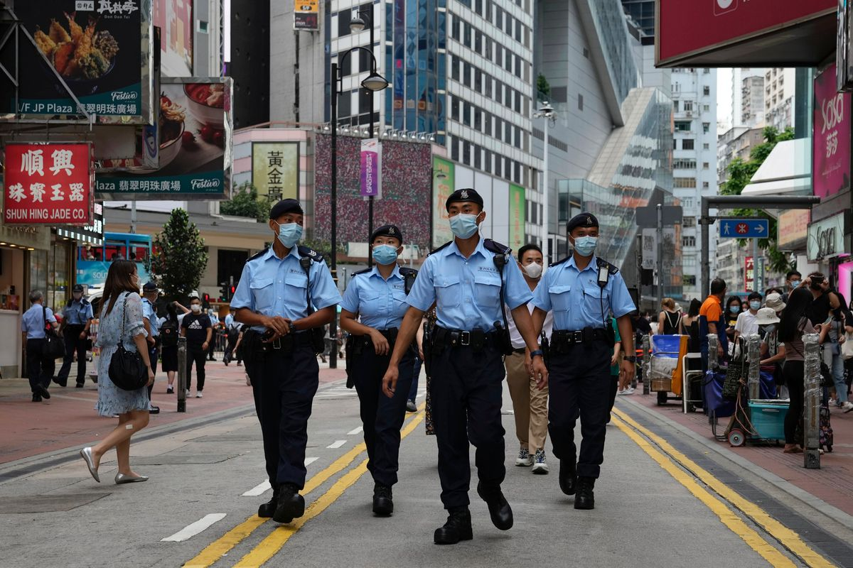 Police officers patrol near the Victoria Park in Hong Kong, Friday, June 4, 2021.