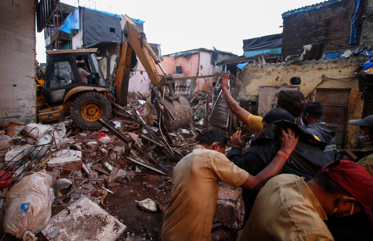 Rescuers clear the debris to find any residents possibly still trapped after a three-story dilapidated building collapsed following heavy monsoon rains n Mumbai, India, Thursday, June 10, 2021. (AP Photo/Rafiq Maqbool).