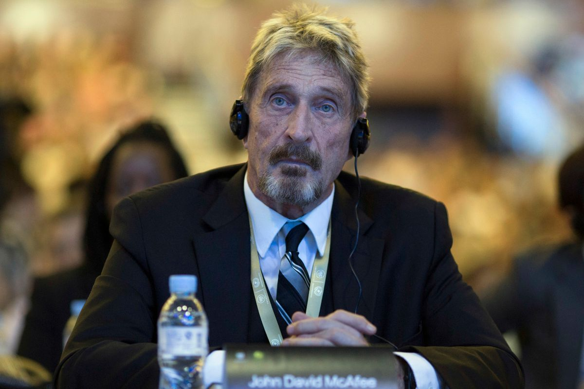 FILE - In this Tuesday, Aug. 16, 2016 file photo, software entrepreneur John McAfee listens during the 4th China Internet Security Conference (ISC) in Beijing.