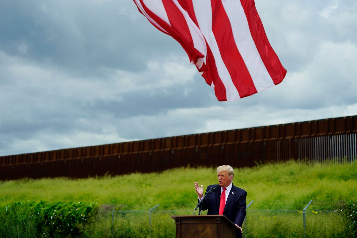 Former President Donald Trump speaks during a visit to an unfinished section of border wall with Texas Gov. Greg Abbott, in Pharr, Texas, Wednesday, June 30, 2021.