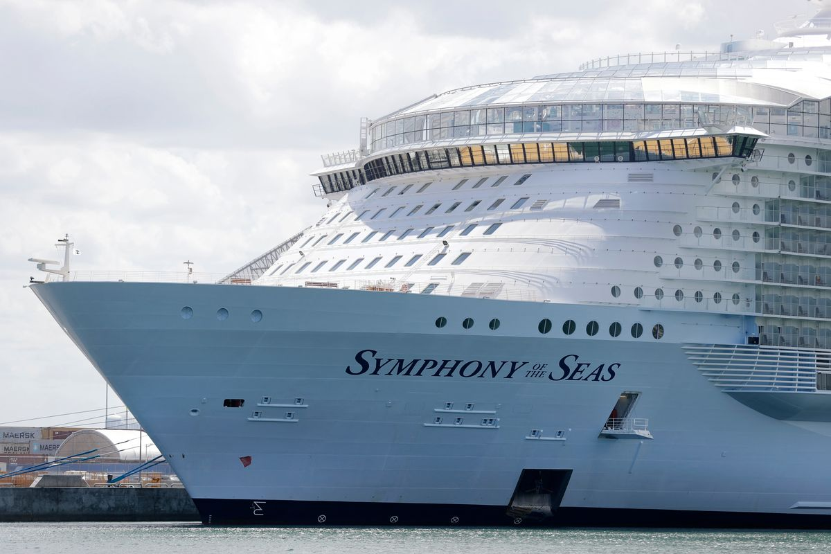 FILE - The Symphony of the Seas cruise ship is shown docked at PortMiami, Wednesday, May 20, 2020, in Miami.