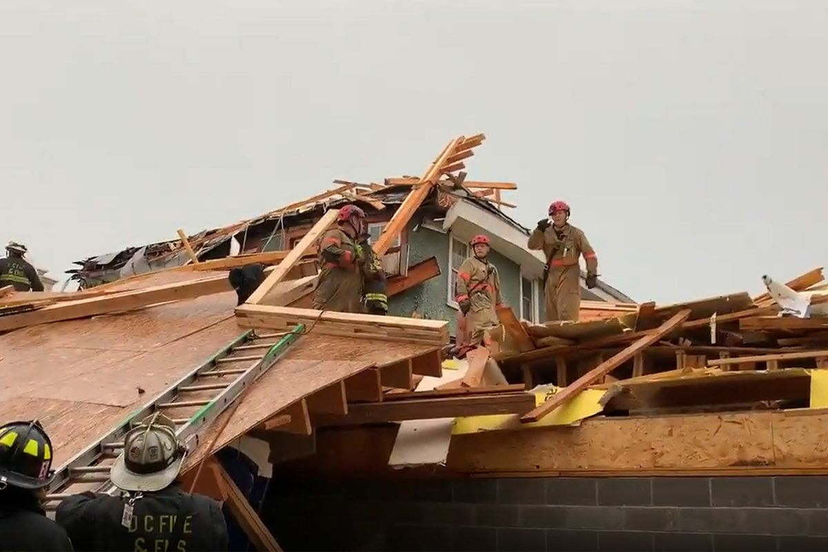 Fire crews worked to rescue a person after a building collapsed in Washington, D.C.