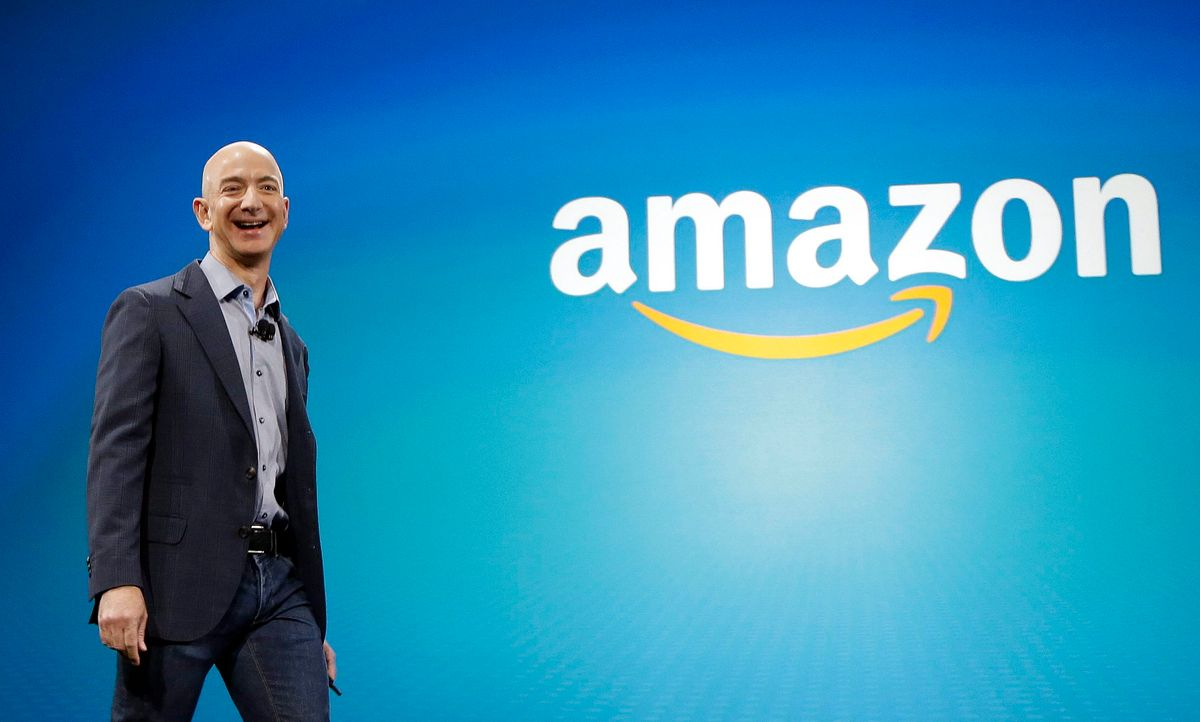 In this June 16, 2014 file photo, Amazon CEO Jeff Bezos walks onstage for the launch of the new Amazon Fire Phone, in Seattle.