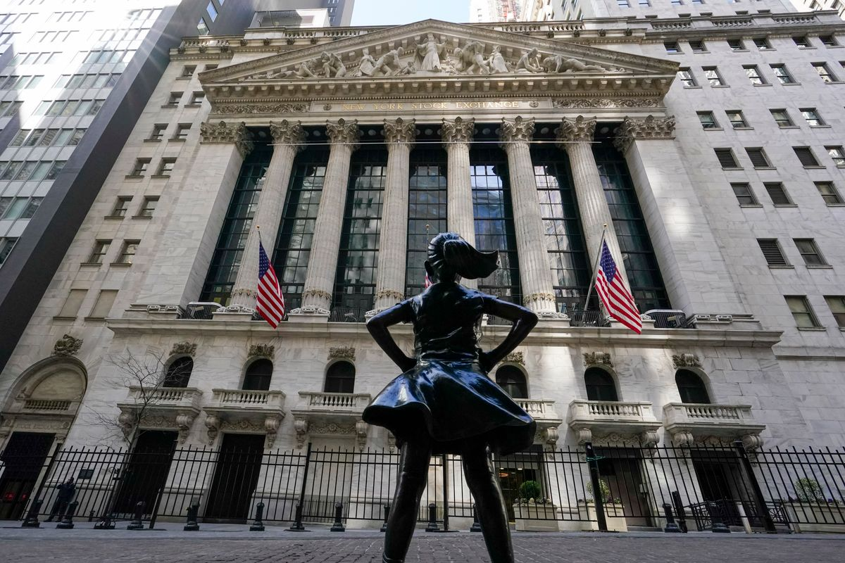 FILE - In this March 23, 2021 file photo, the Fearless Girl statue stands in front of the New York Stock Exchange in New York's Financial District.