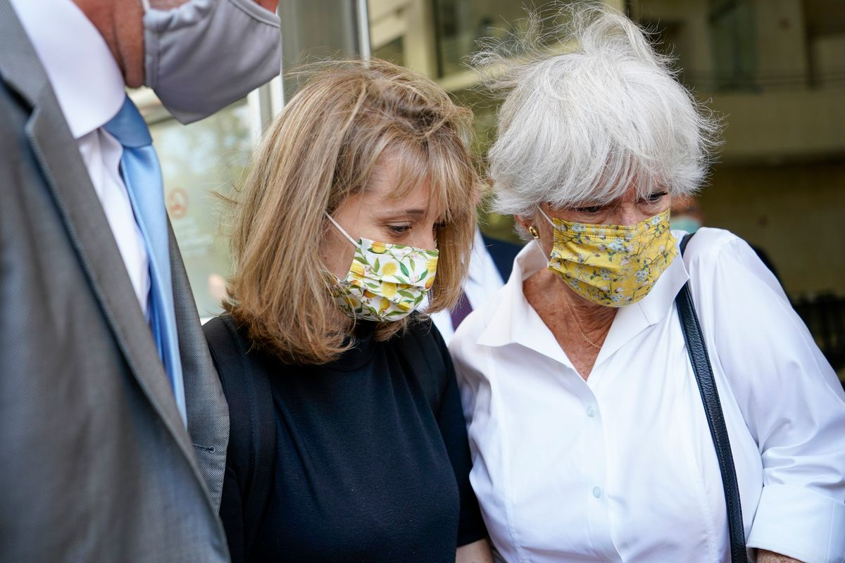 Allison Mack, center, leaves federal court with her mother Mindy Mack after being sentenced, Wednesday, June 30, 2021, in New York.