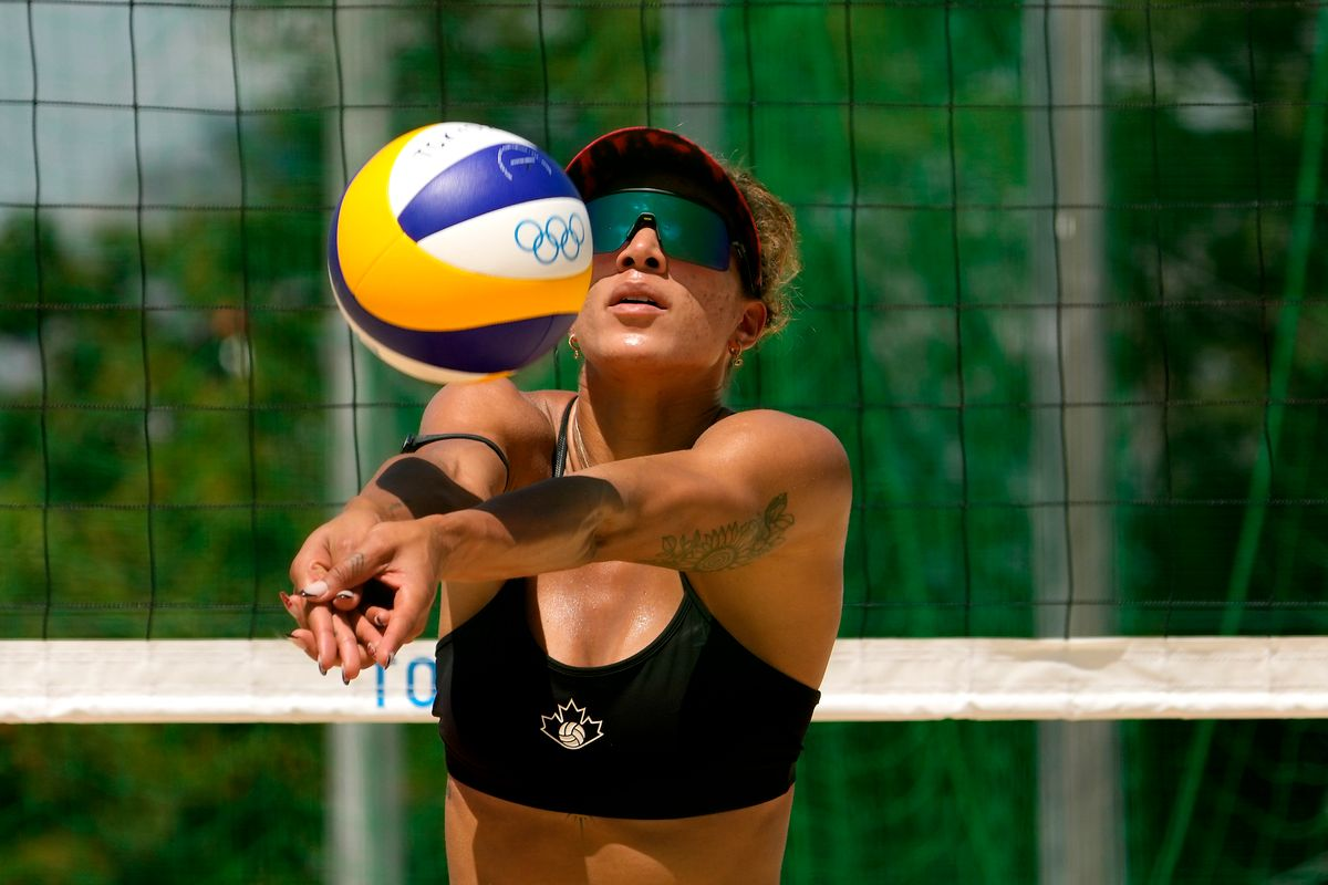 Brandie Wilkerson, from Canada, practices during women's beach volleyball practice at the 2020 Summer Olympics, Monday, July 19, 2021, in Tokyo. (AP Photo/Charlie Riedel).