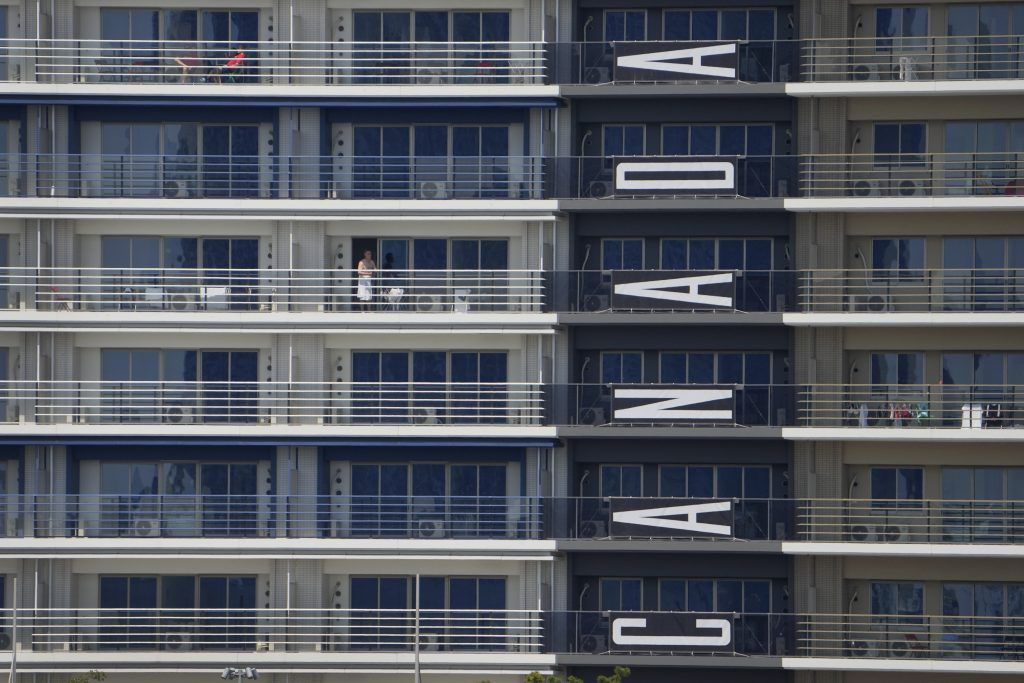 A banner hangs from Canada team apartments in the Olympic athletes' village ahead of the 2020 Summer Olympics, Monday, July 19, 2021, in Tokyo.
