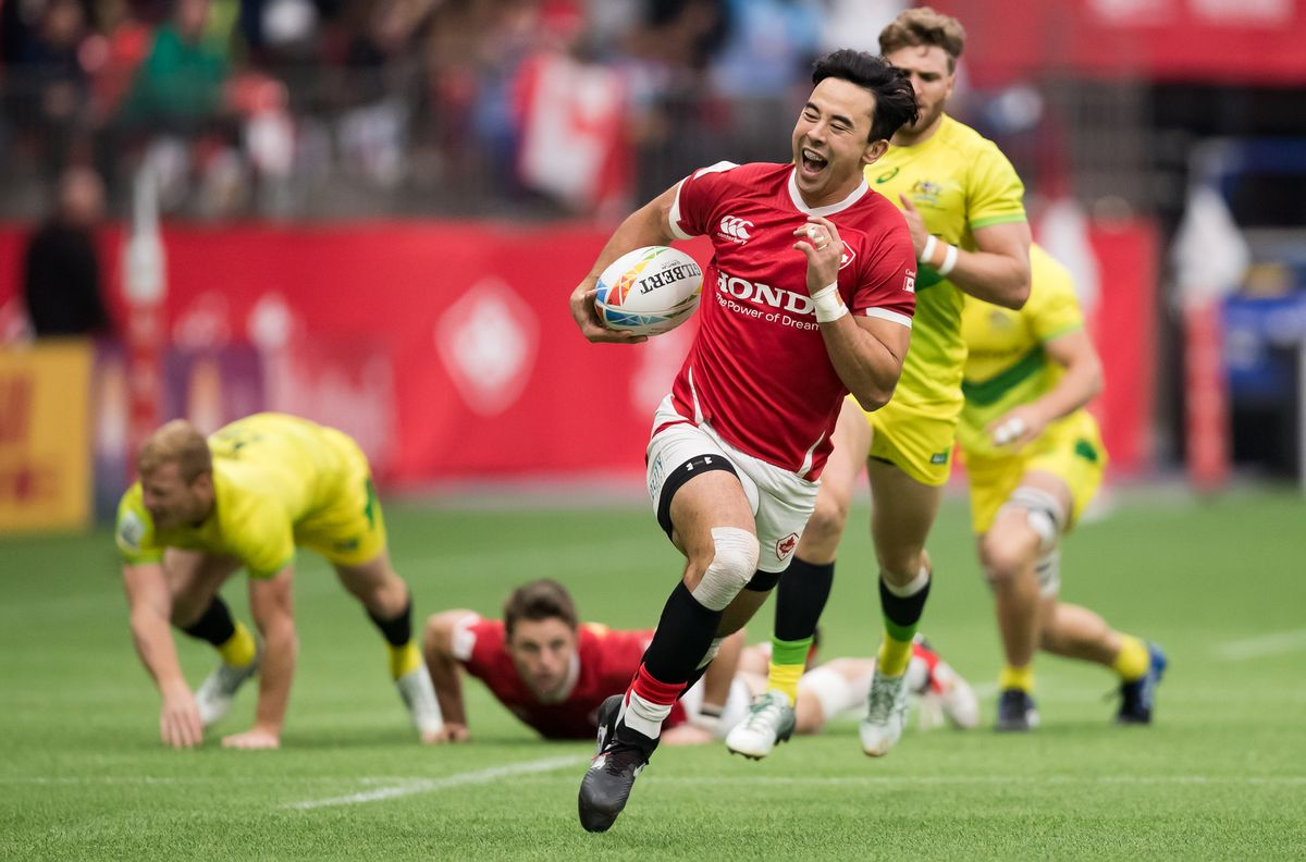 Canada's Nathan Hirayama, front, runs the ball towards the try zone before passing to Harry Jones who scored, during a semifinal match against Australia at the Canada Sevens rugby tournament in Vancouver, on Sunday, March 8, 2020. Women's basketball player Miranda Ayim and men's rugby sevens player Nathan Hirayama have been named Canada's flag-bearers for the opening ceremony of the Tokyo Olympics.THE CANADIAN PRESS/Darryl Dyck.