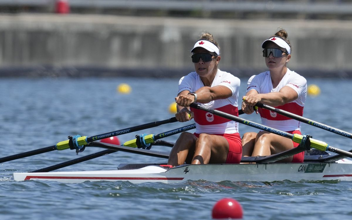 Jessica Sevick and Gabrielle Smith, of Canada, competes in the women's double sculls at the 2020 Summer Olympics, Friday, July 23, 2021, in Tokyo, Japan. (AP Photo/Darron Cummings).