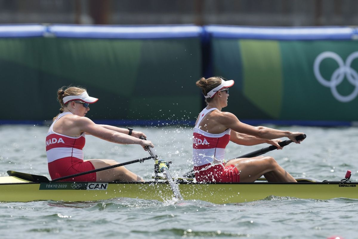 Caileigh Filmer and Hillary Janssens of Canada compete in the women's rowing pair semifinal at the 2020 Summer Olympics, Wednesday, July 28, 2021, in Tokyo, Japan. (AP Photo/Darron Cummings).