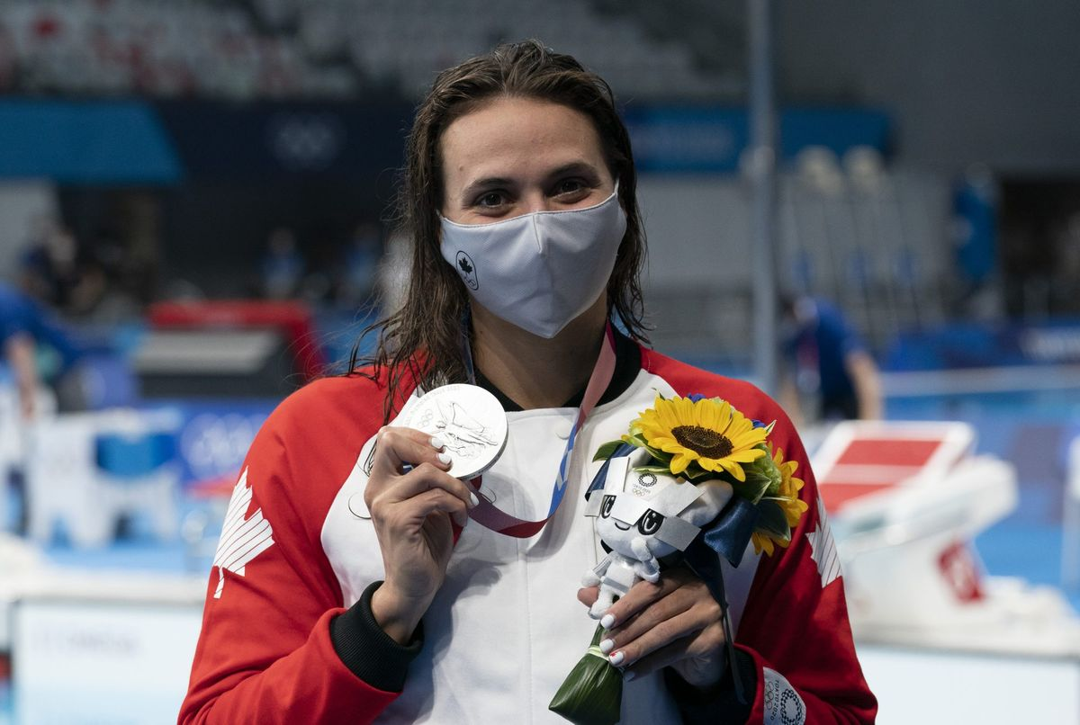 Canadian swimmer Kylie Masse, from LaSalle, Ont. holds up her silver medal in the women's 200m backstroke at the Tokyo Olympics, Saturday, July 31, 2021 in Tokyo, Japan. THE CANADIAN PRESS/Adrian Wyld.