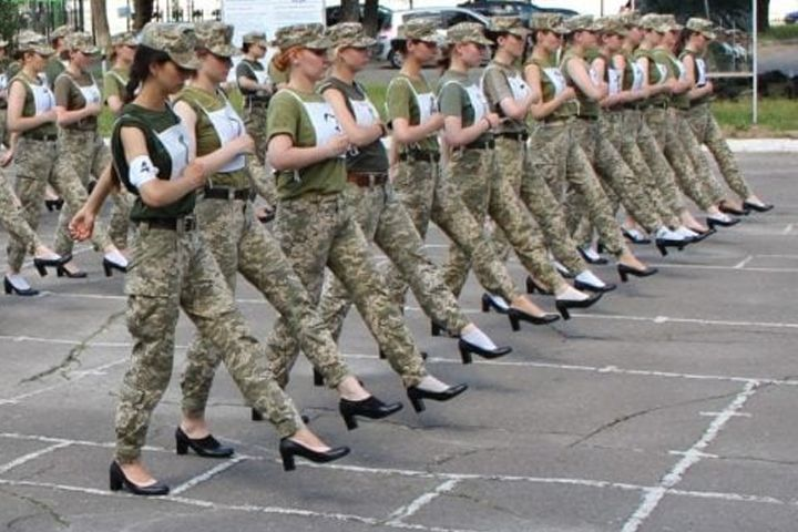 Female cadets march in preparation for Ukraine's independence day celebrations.
