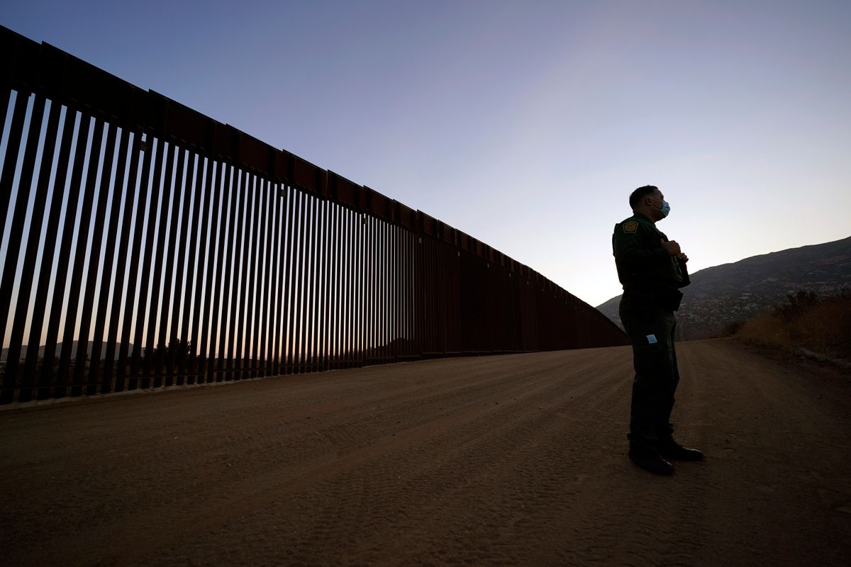 Border Patrol agent Justin Castrejon speaks in front of newly replaced border wall sections Thursday, Sept. 24, 2020, near Tecate, Calif.