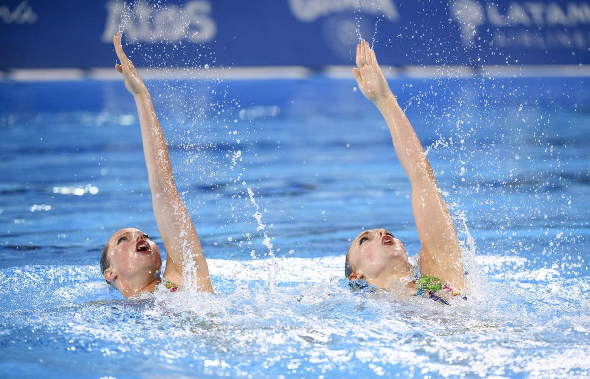 Claudia Holzner and Jacqueline Simoneau of Canada compete in artistic swimming duets at the Pan American Games in Lima, Peru on Wednesday, July 31, 2019. THE CANADIAN PRESS/HO, COC, Christopher Morris.