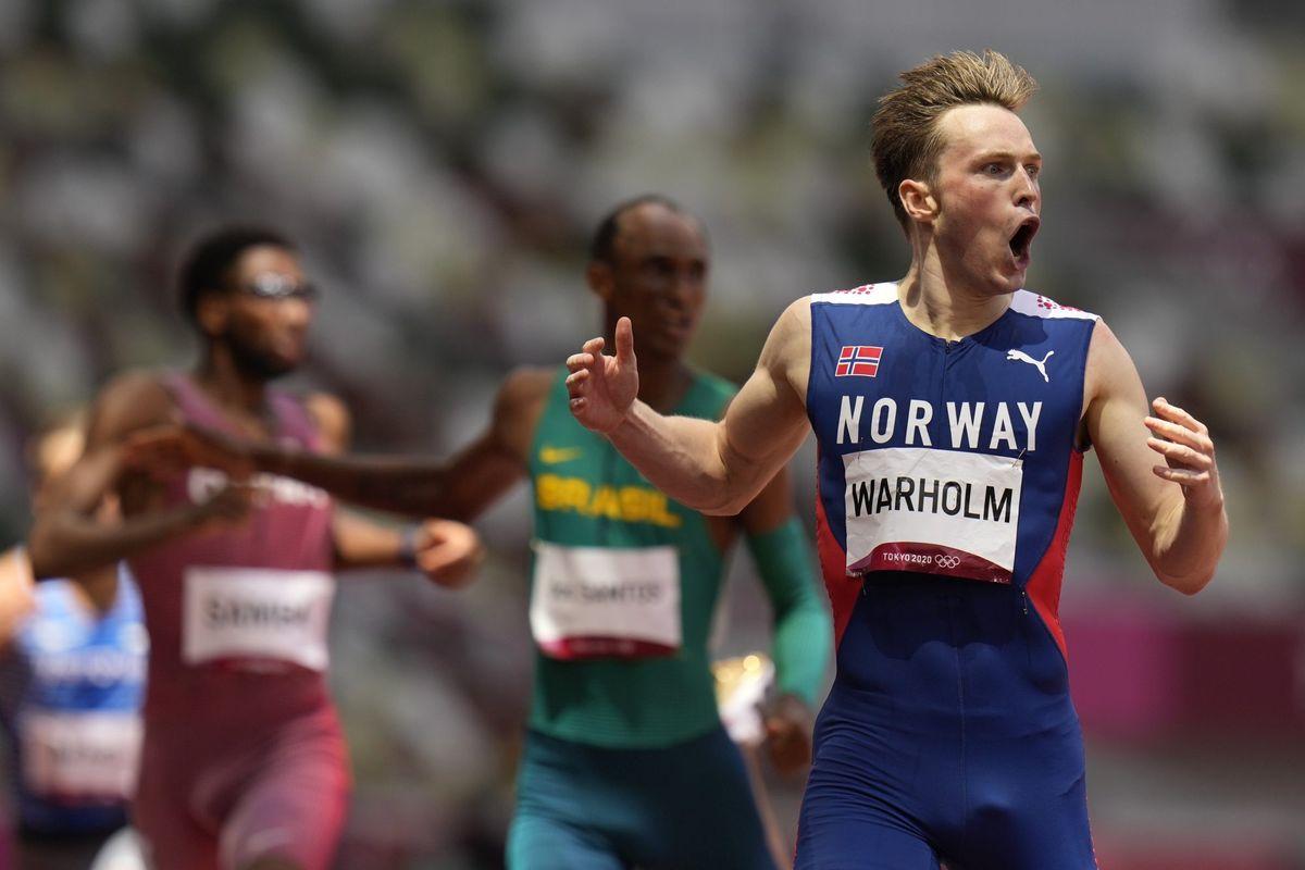 Karsten Warholm, of Norway, reacts after winning the men's 400-meter hurdles final at the 2020 Summer Olympics, Tuesday, Aug. 3, 2021, in Tokyo. (AP Photo/Petr David Josek).