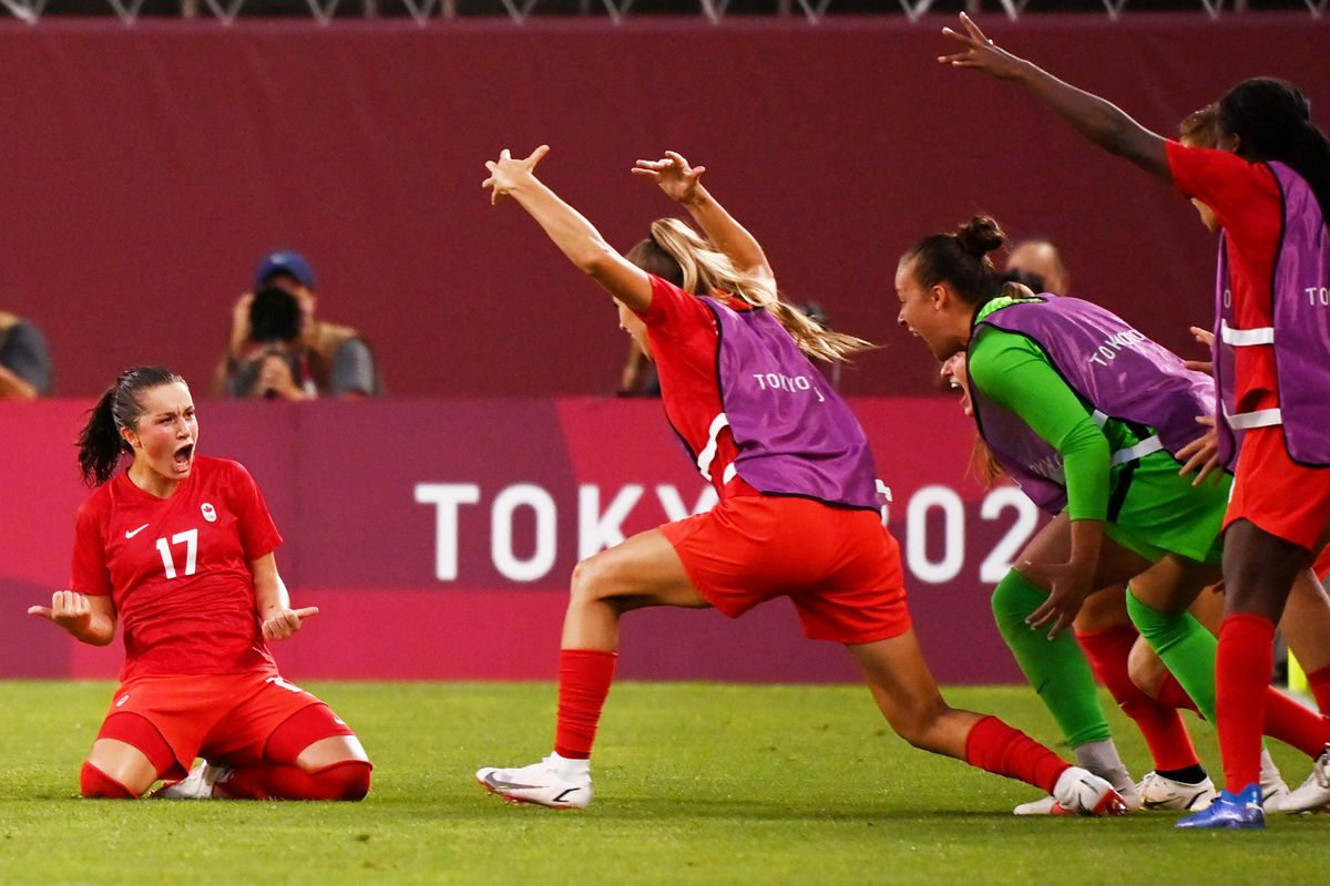 Canada's midfielder Jessie Fleming (L) celebrates with teammates after scoring the opening goal during the Tokyo 2020 Olympic Games women's semi-final football match between the United States and Canada at Ibaraki Kashima Stadium in Kashima on August 2, 2021.
