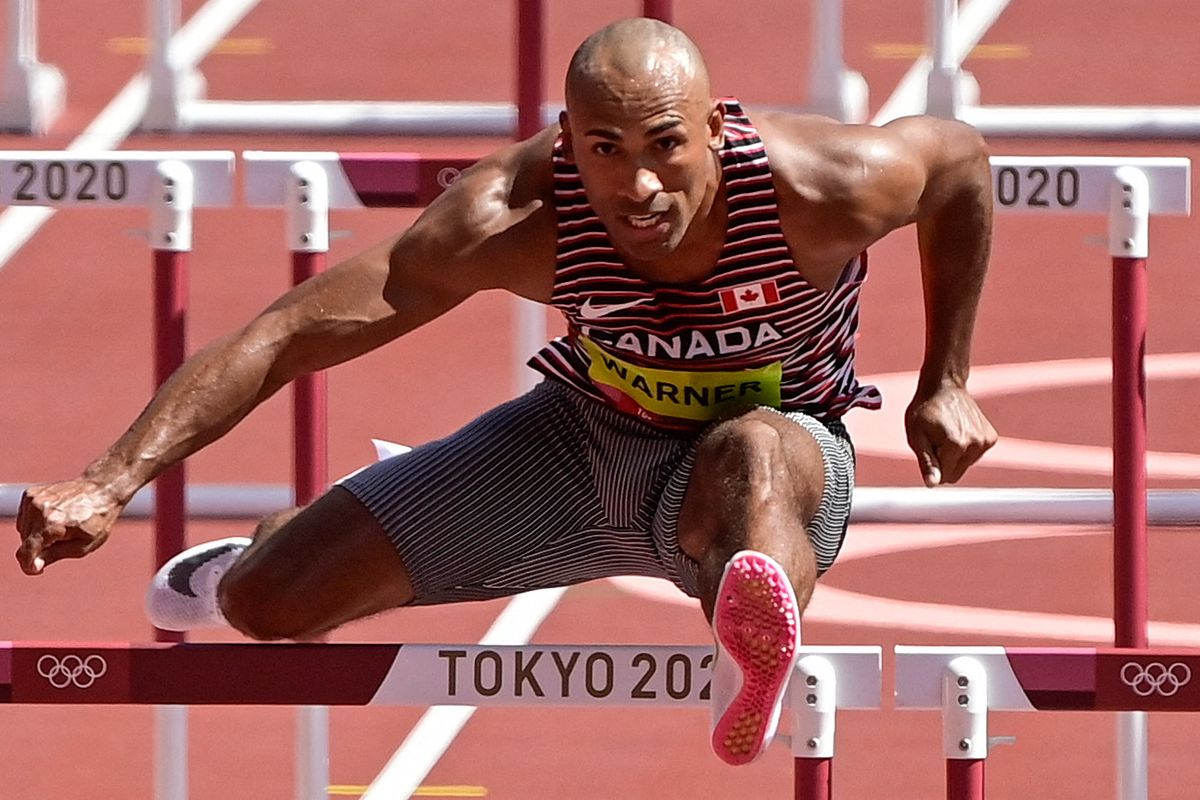 Canada's Damian Warner competes in the men's decathlon 110m hurdles during the Tokyo 2020 Olympic Games at the Olympic Stadium in Tokyo on August 5, 2021.