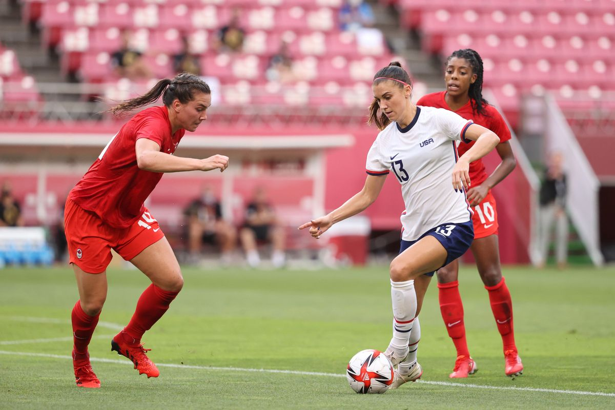 Alex Morgan #13 of Team United States runs with the ball during the Women's Semi-Final match between USA and Canada on day ten of the Tokyo Olympic Games at Kashima Stadium on August 02, 2021 in Kashima, Ibaraki, Japan.