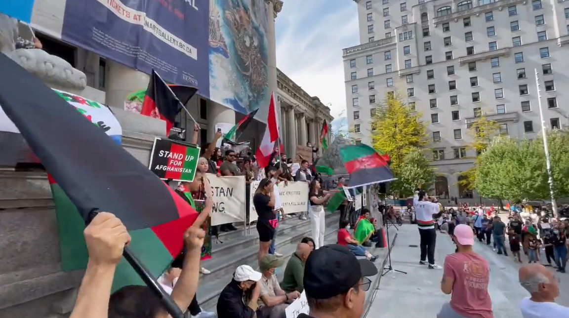 People rally at the Vancouver Art Gallery in support of Afghans now facing Taliban rule.